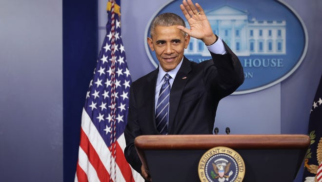 President Obama waves goodbye at the conclusion of a news conference at the White House on Dec. 16, 2016.
