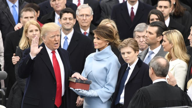 Donald Trump takes the oath of office,while standing with Melania Trump and Baron Trump, during the 2017 Presidential Inauguration at the U.S. Capitol on Jan. 20.