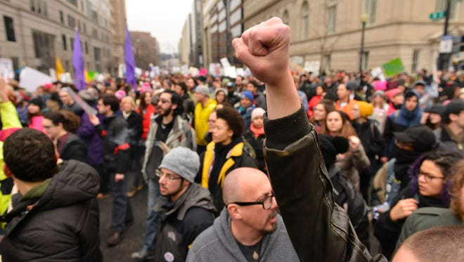 Jan 20, 2017; Washington, DC, USA; Protesters march near McPherson Square on I street  after Donal Trump was sworn in during the 2017 Presidential Inauguration at the National Mall. Mandatory Credit: Sean Dougherty-USA TODAY