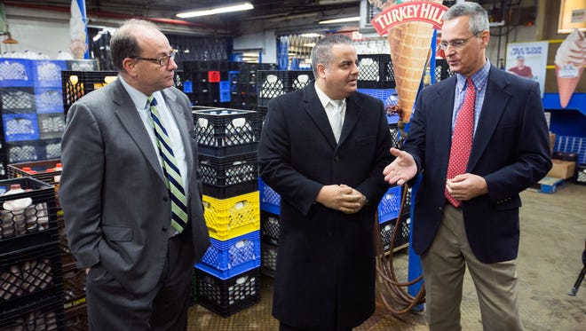 From left, Binghamton Director of Economic Development Robert Murphy, Binghamton Mayor Richard David, and Dave King, Instantwhip Foods Eastern New York General Manager, tour the Instawhip distribution center at 145 Conklin Ave. on Tuesday.