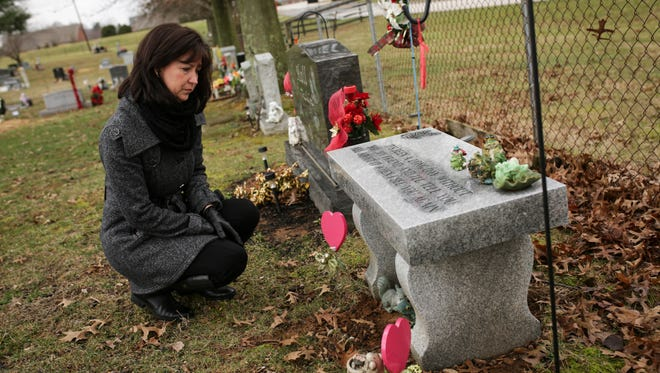 """Jennifer Powell visits the gravesite of her younger sister, Jolene Berger-Bowman, who died in a church bathroom from an overdose after taking a pill that ended up containing fentanyl, which is up to 50 times more potent that heroin. Berger-Bowman had been sober for 16-months and had went back to work, was living on her own and raising her children. """"Her dealer had been reaching out to her for months,"""" Powell said. """"I don't know what took her back to that place again."""" The pill was a counterfeit pill, made to look like a lortab, or oxycotin. """"She thought she was getting a pain pill,"""" Powell said. Jan. 24, 2017"""