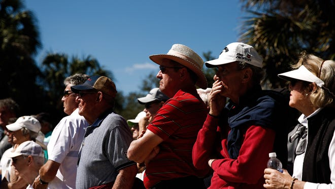 Spectators watch the action during the final round of the Chubb Classic at Twin Eagles Golf Club on Sunday, Feb. 14, 2016.