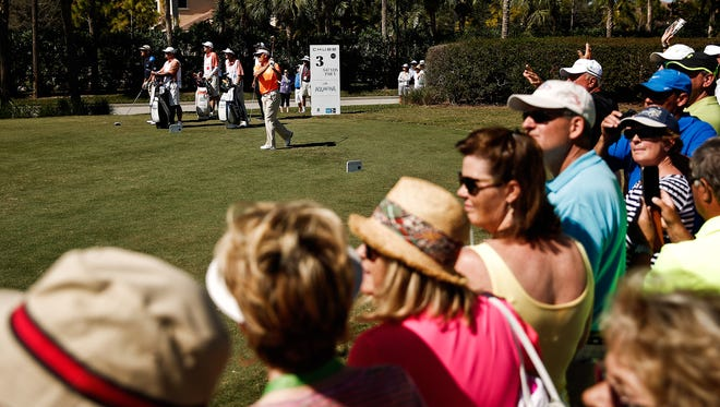 Spectators watch Bernhard Langer's shot at the 3rd hole during the final round of the Chubb Classic at Twin Eagles Golf Club on Sunday, February 14, 2016.