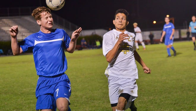 Titusville and Merritt Island compete in the district finals boy soccer match at Satellite High School.