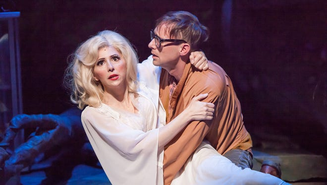 "As ""Little Shop of Horrors"" nears its finale, Audrey (Gina Milo) and nerdy florist's assistant Seymour (Nick Cearley) sing of their undying love for one another. The show runs at the Cincinnati Playhouse in the Park through Feb. 19."