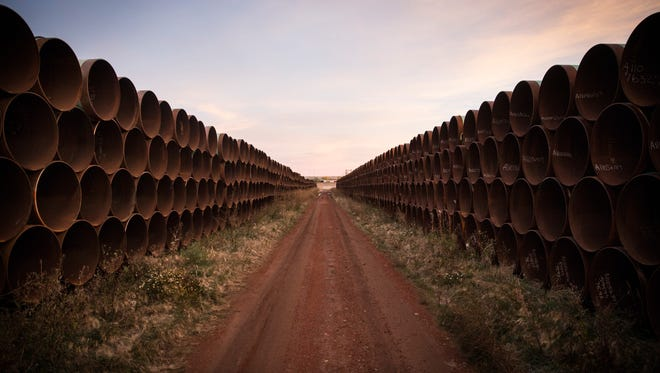 FILE - Miles of unused pipe, prepared for the proposed Keystone XL pipeline, sit in a lot on October 14, 2014 outside Gascoyne, North Dakota.