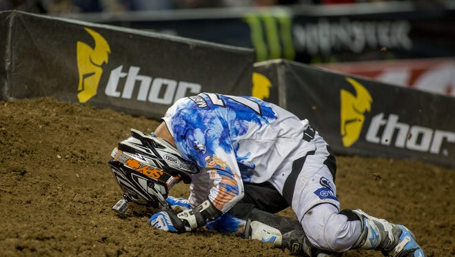 250sx rider Cole Martinez reacts after crashing on a turn during a qualifying round at the 2015 Monster Supercross event at Chase Field in Phoenix January 10, 2015.
