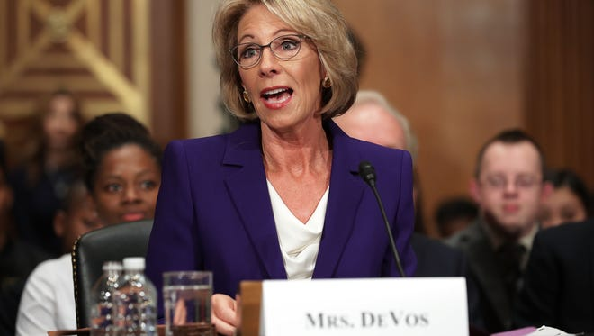 Betsy DeVos, President-elect Donald Trump's pick to be the next secretary of Education, testifies Jan. 17 during her confirmation hearing before the Senate Health, Education, Labor and Pensions Committee.