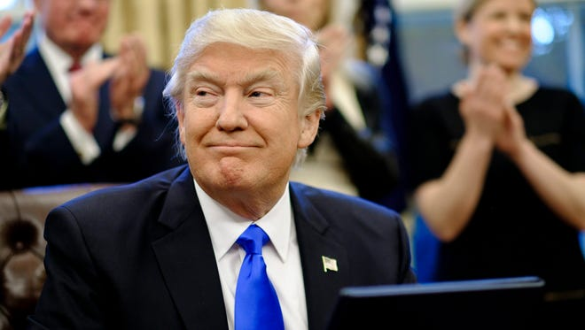 President Donald Trump signed an executive order temporarily banning immigration from seven predominately Muslim countries on Jan. 27, 2017.