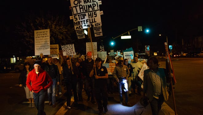 Hundreds march from Frances Stevens Park in Palm Springs to protest President Trump's executive actions on immigration, Thursday, Feb. 2, 2017.