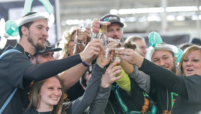 Revelers cheers during the 8th annual Brewers of Indiana Guild Winterfest, at the Indiana State Fairgrounds, Feb. 4, 2017. The event  features 101 Hoosier breweries, and directly supports IndianaÕs brewing community.