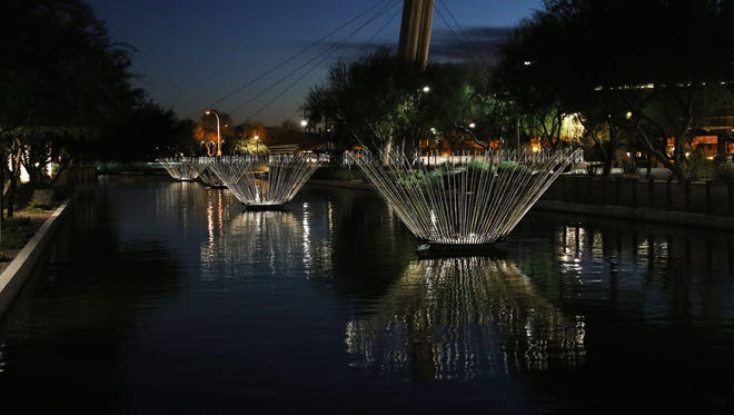 "Mark PickthallBruce Munro?s illuminated works of art, ?Blooms,? light up the Scottsdale Waterfront.""Blooms"": You can't miss Bruce Munro's illuminated works of art lighting up the Scottsdale Waterfront."