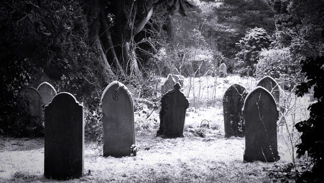 Grave stones in the snow in balck and white