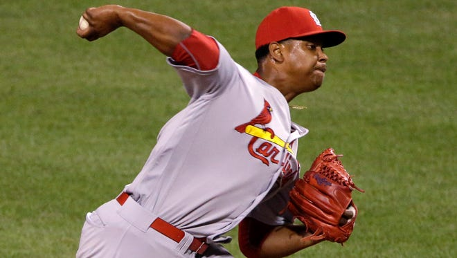 FILE - In this Sept. 7, 2016, file photo, ,St. Louis Cardinals starting pitcher Alex Reyes delivers during the sixth inning of a baseball game against the Pittsburgh Pirates, in Pittsburgh. A day after St. Louis' pitchers and catchers reported to spring training, the Cardinals received some concerning news when heralded rookie Alex Reyes wasn't cleared yet by team doctors to throw. (AP Photo/Gene J. Puskar, File)