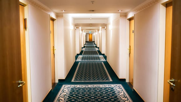 Adjoining rooms are next to each other, but not connected