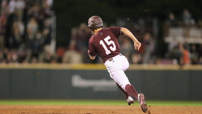 Mississippi State's Jake Mangum (15) rounds second base on his way to scoring in the third inning. Mississippi State played Texas Tech in the 2017 baseball season-opener on Friday, February 17 at Dudy Noble Field in Starkville. Photo by Keith Warren