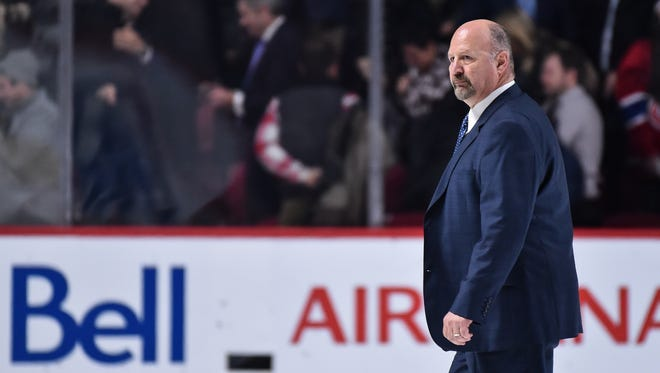 Claude Julien looks on as he walks across the ice during the NHL game against the Montreal Canadiens at the Bell Centre on December 12, 2016 in Montreal, Quebec,