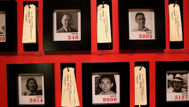 Pictures of people who were incarcerated at Manzanar War Relocation Center are displayed alongside family tags at Manzanar National Historic Site near Independence, California.