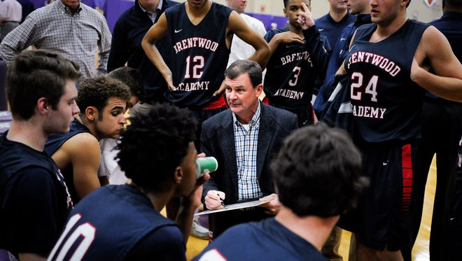 Brentwood Academy coach Hubie Smith works with his team during a timeout in a game against Father Ryan on Feb. 17, 2017.