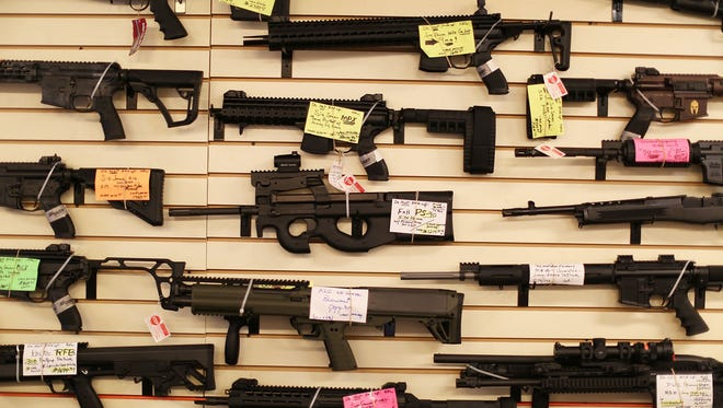Weapons are displayed at a gun store in Delray Beach, Fla.