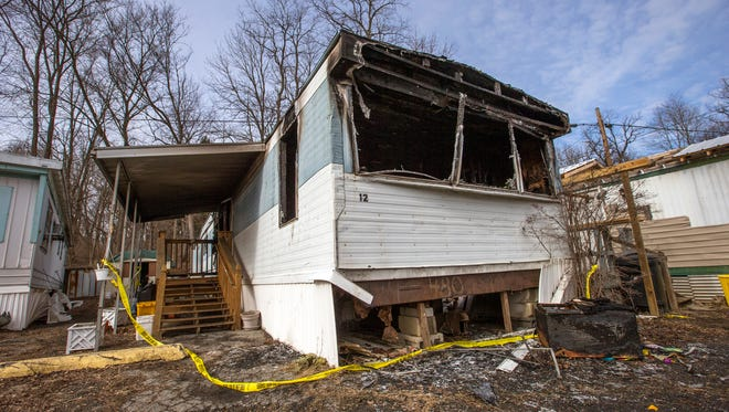The scene of Sunday's fatal fire at 417 West Service Road in Hillcrest where an elderly woman was killed.