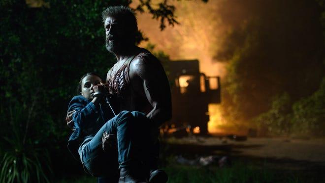 "Logan/Wolverine (Hugh Jackman) tries to keep Laura (Dafne Keen) out of harm's way in ""Logan."""