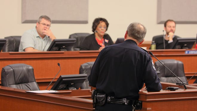 LMPD Chief Steve Conrad, center, speaks during a Public Safety Committee meeting at Metro Council Chambers in Louisville, KY.  Mar. 1, 2017