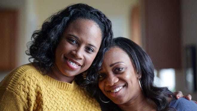 """Sisters Lana Hayes, left, and Lennia """"Nia"""" Hayes, pose for a photo after meet for the first time Feb. 28, 2017. For the past eight years, the two have lived a mile apart in Fishers, Ind., without knowing it."""