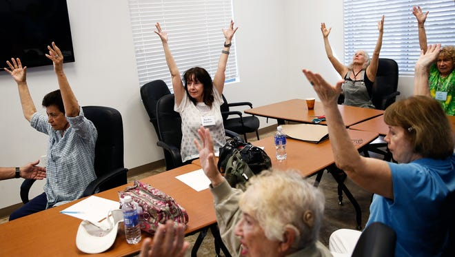 Members of a writers group perform a series of stretches during a creativity workshop led by Patton White at the Naples Senior Center on Friday, March 11, 2016. The workshops were made possible by NEA funding.  (Scott McIntyre/Naples Daily News)