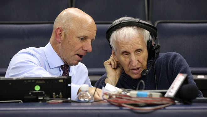Marty Aronoff, right, talks with ESPN announcer Sean McDonough during a game between North Carolina and Virginia last week.