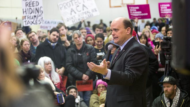 23rd District Representative Tom Reed speaks to residents during a town hall meeting at the Southside Community Center in Ithaca on Saturday, March 11, 2017.