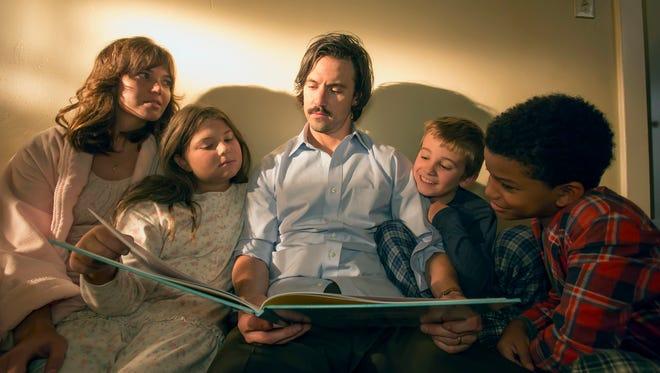 Reading to the Big Three:  Mandy Moore, left, Mackenzie Hancsicsak, Milo Ventimiglia, Parker Bates and Lonnie Chavis.