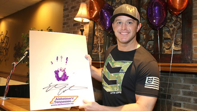 """Country artist Easton Corbin adds his handprint to the Alzheimer's Tennessee """"AlzStar Hall of Fame"""" after his performance at the kickoff for the 27th annual Knoxville Alzheimer's Tennessee Walk coming up Sunday, April 9, at UT Gardens."""
