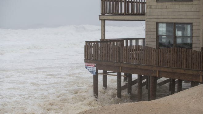 The beach takes a beating from the storm. Ocean water washes through the pilings of the Golden Gull. A coastal low develops bringing high winds and heavy rain throughout the shore area. Intense winds create huge ocean waves that batter beaches up and down the coast.Ortley Beach, NJTuesday, March 14, 2017.@dhoodhood
