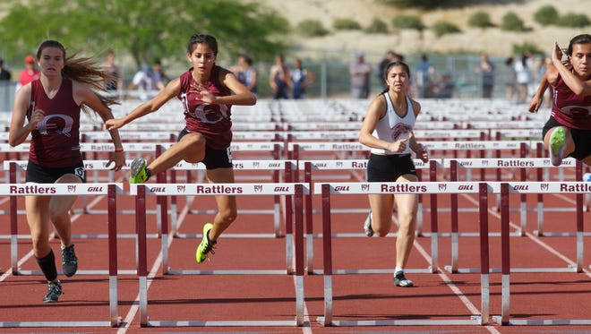La Quinta and Rancho Mirage runners compete in the 100 meter hurdles race at Rancho Mirage High School, Wednesday, March 22, 2017.