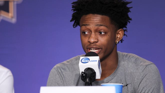 De'Aaron Fox answers a question on the dais during off-day press conferences Saturday in Memphis.  The Cats will take on North Carolina Sunday afternoon in Memphis to advance to the Final Four.March 25, 2017