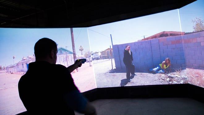 Binghamton Police patrolman Chris Governanti participates in an overdose simulation where a subject pulled a gun on Tuesday.