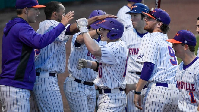 Teammates congratulate University of Evansville's Travis Tokarek after home run during an Aces' home game last season against Southern Illinois Edwardsville.