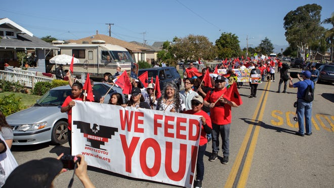 Demonstrators march along Juanita Avenue during the Chavez March held Sunday in Oxnard.
