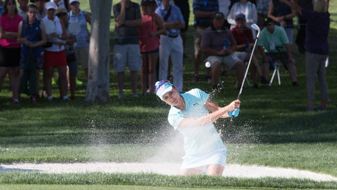 Lexi Thompson hits onto the green of the 11th hole at the ANA Inspiration, Sunday, April 2, 2017.