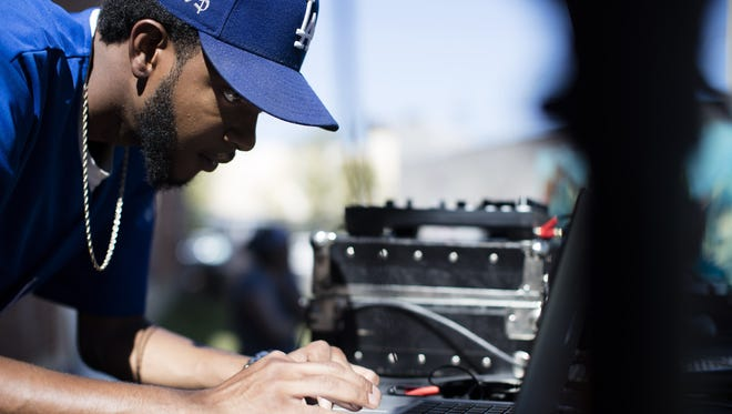 Axel Roley played music during the 2016 LouiEvolve Hip Hop and Arts Festival.