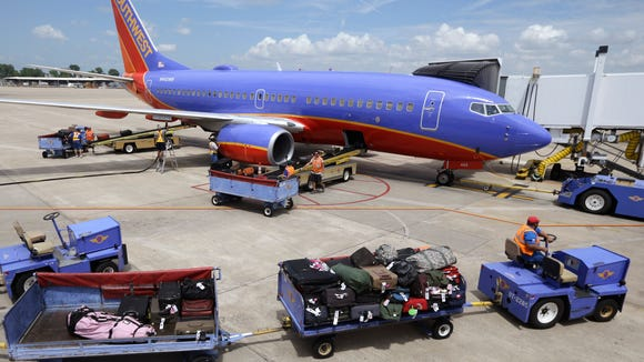 In this file photo from June 19, 2014, baggage carts
