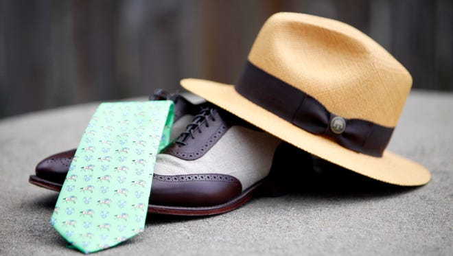 """Brett Howard, owner of the men's clothing store Evolve, put together a classic option for men's derby fashion. Featured is a Vinyard Vines jockey and horse tie, Allen Edmonds """"Spectator"""" shoes, and a traditional hand-woven Panama hat. April 5, 2015"""
