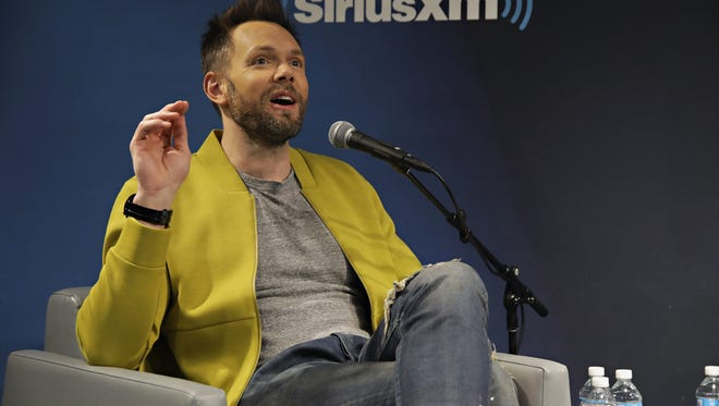 """NEW YORK, NY - FEBRUARY 17:  Actor Joel McHale discusses his new CBS sitcom during a SiriusXM """"Town Hall"""" event in New York with host Ron Bennington at the SiriusXM studio on February 17, 2017 in New York City.  (Photo by Cindy Ord/Getty Images for SiriusXM)"""