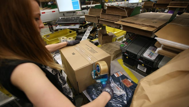 A parcel is prepared for dispatch at Amazon's warehouse.