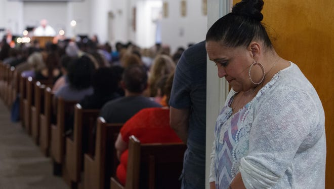 Suzanne Sullivan cries during a prayer service at Our Lady of the Assumption Church in San Bernardino, Calif., following a school shooting at North Park Elementary School which left one student and a teacher dead, Monday, April 10, 2017.