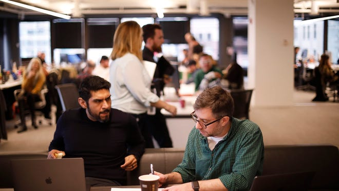 Vic Sanchez, left, and Jon Morgan, both creative directors, work on a concept at an open table space at We Are Unlimited, McDonald's new standalone advertising agency in Chicago.