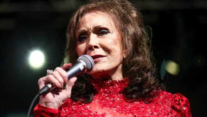 Loretta Lynn performs at the BBC Music Showcase at Stubb's during South By Southwest  in Austin, Texas. The eight-time CMA winner was the very first female vocalist of the year and she's planning be at the 50th annual CMA Awards next Wednesday as many of her career milestones have played out on that stage. (Photo by Rich Fury/Invision/AP, File)