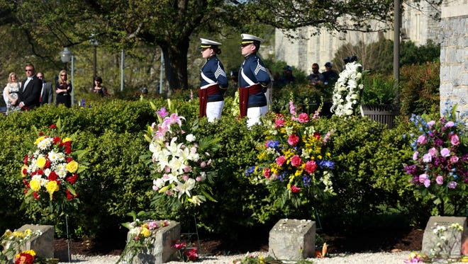 Members of the Virginia Tech Corps of Cadets stand at attention on the Virginia Tech campus in Blacksburg, Va,. on, April 16, 2017, during a 10th anniversary observance of a mass shooting that killed 32.
