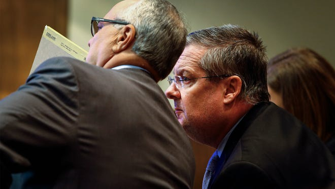 Shelby County businessman Mark Giannini (right) talks with lawyer Steve Farese (left) during his aggravated rape trial in Judge Mark Ward's courtroom.